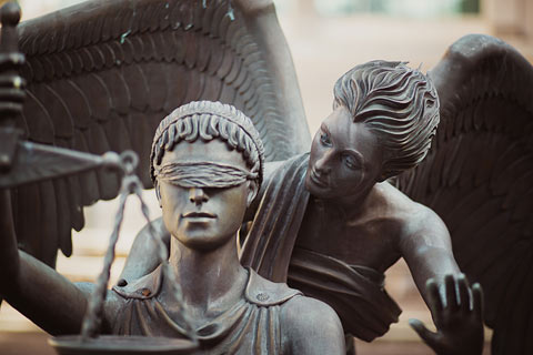 justice and mercy statue
